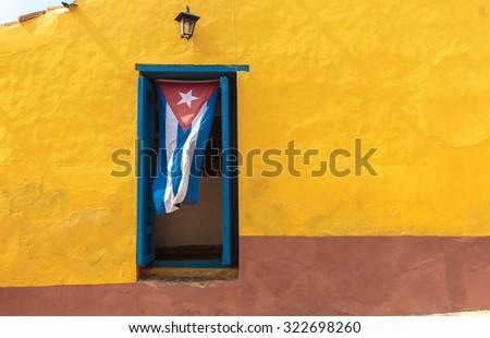 Cuban flag hanging on a door in Trinidad, Cuba - stock photo