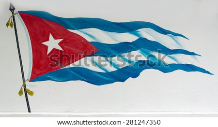Cuban flag painted in white wall, creative and beautiful drawing of the Cuba's flag tied to a flagpole with a white background. - stock photo