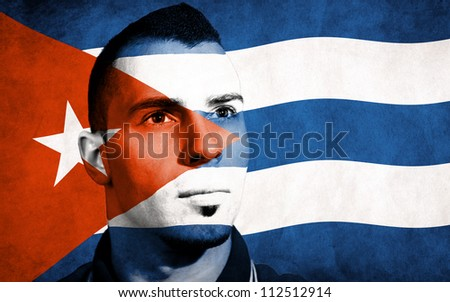 Cuban flag painted on his face - stock photo