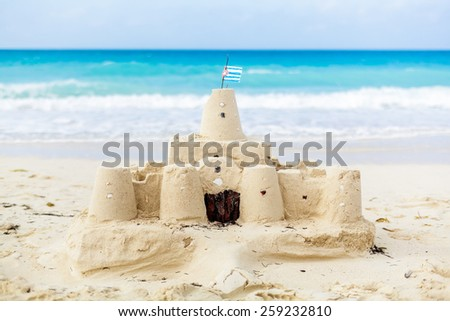 Cuban Sandcastle with the country Flag on one of the most Beautiful Beach of Cuba - stock photo