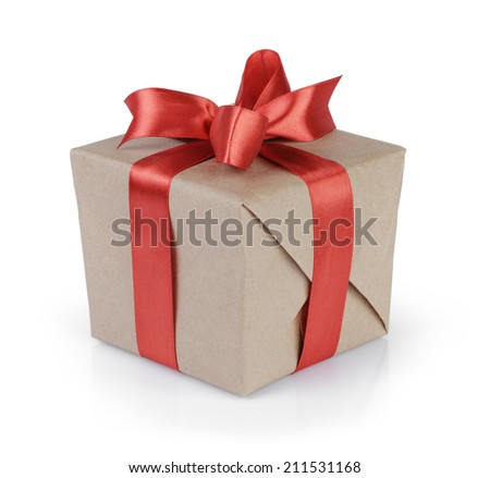 cube gift box wrapped with kraft paper and red bow, isolated - stock photo