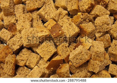 Cubed rye bread drying to make croutons - stock photo