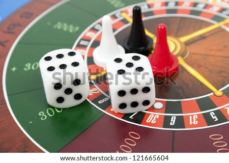 cubes and counters  on roulette background - stock photo