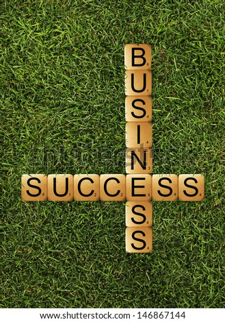 cubes crossword success of business - stock photo