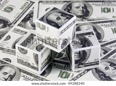 cubes made from dollars to background notes - stock photo