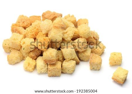 Cubes of bread piled on top of each other. - stock photo