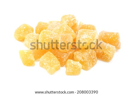 Cubes of crystallised stem ginger, isolated on a white background - stock photo
