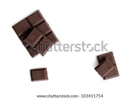 Cubes of dark chocolate view from above - stock photo