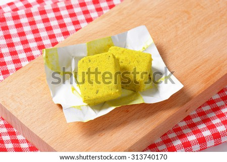 cubes of dehydrated chicken-based bouillon