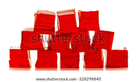 Cubes of red jelly on a white background - stock photo
