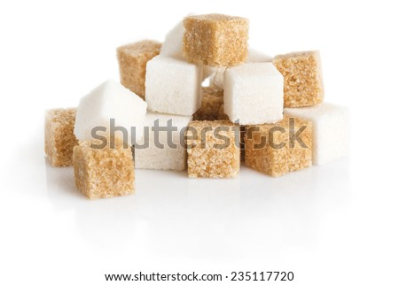 cubes of sugar cane brown and white refined isolated on white background - stock photo