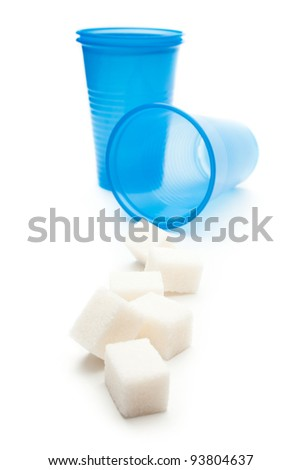 Cubes of sugar with plastic cups