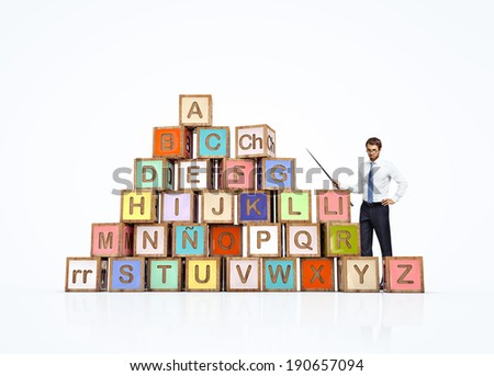 Cubes with spanish alphabet and teacher. Alfabeto espa�±ol y professor - stock photo