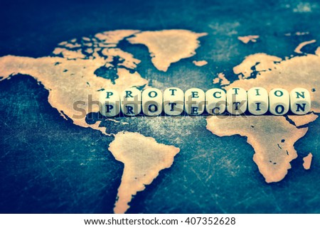 Cubes with text, PROTECTION, on world map, vintage effect