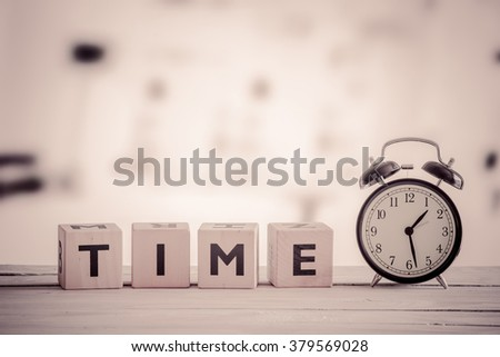 Cubes with the word time in sepia colors - stock photo