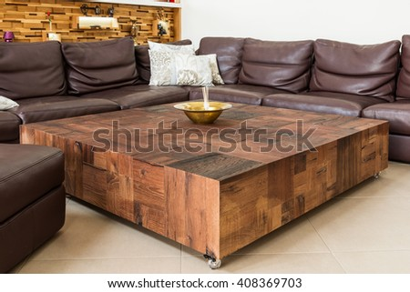 Cubist luxury wooden table and leather sofa is back