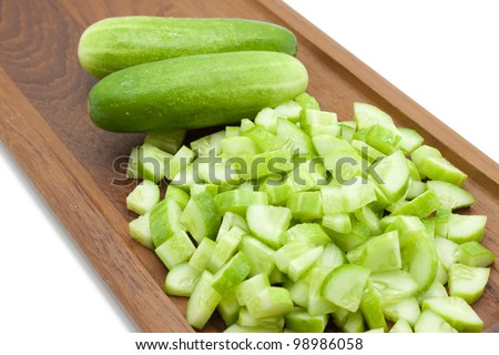 Cucamber on a wood  block - stock photo