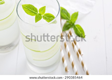 Cucumber cooler in tall glasses garnished with basil