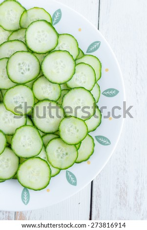Cucumber   Freshly Sliced Cucumber pieces are placed on a Rustic White Background - stock photo