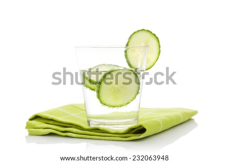 Cucumber lemonade on green table cloth isolated on white background. Healthy fresh summer drink. - stock photo