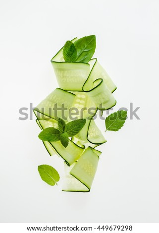 Cucumber noodles with mint leaves - stock photo