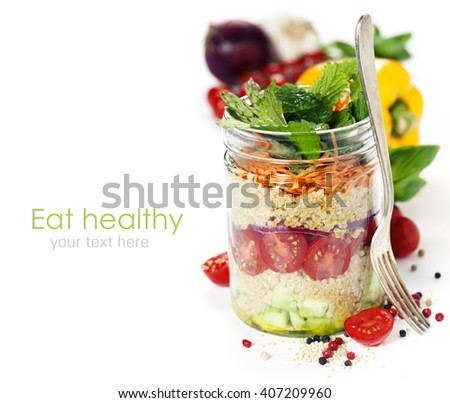 Cucumber, quinoa, tomato, onion, carrot and mint salad in a jar over white - stock photo