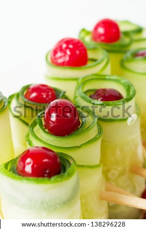 Cucumber rolls with frozen cranberries. Close up.
