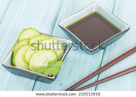 Cucumber Salad - Oriental style cucumber salad and dipping sauce. - stock photo