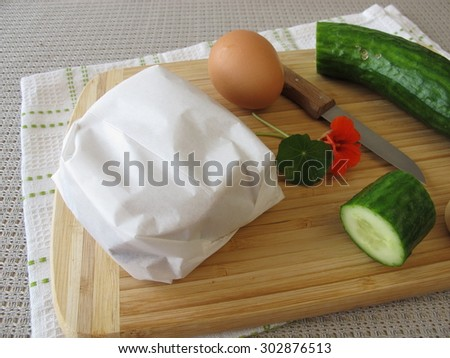 Cucumber sandwich in greaseproof paper