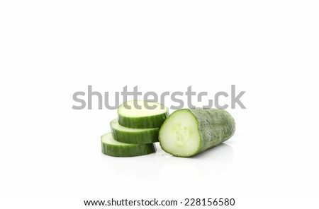 Cucumber slices stacked isolated over white background. - stock photo