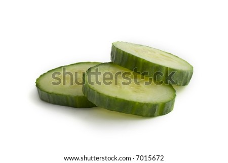 Cucumber Slices Stacked: Straight Product shot taken in Studio in Natural Light isolated against White Background - stock photo
