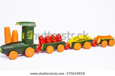 Cucumber train - From cucumbers and other vegetables carved train - stock photo