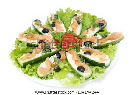 cucumber with fish on a white background - stock photo