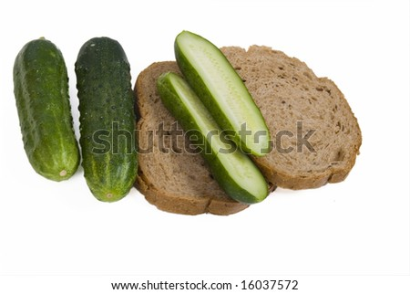 Cucumbers And Bread Isolate On White