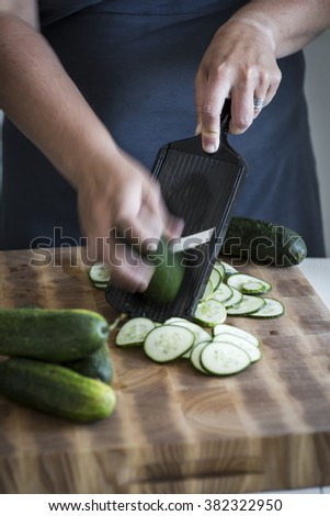 Cucumbers being sliced to be pickled