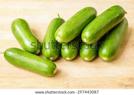 cucumbers on the wooden board