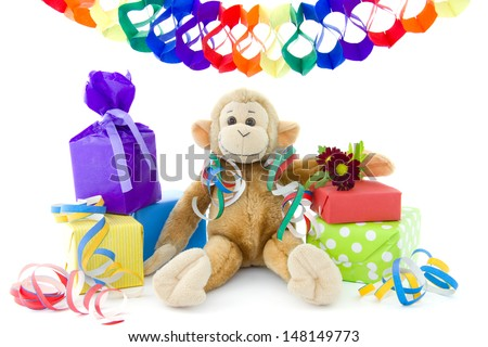 cuddly monkey with colorful presents and guirlande
