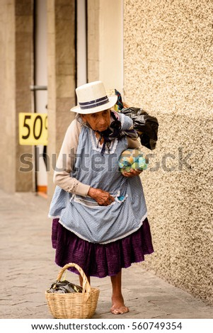 CUENCA, ECUADOR - JAN 9, 2015: Unidentified Ecuadorian woman in traditional clothes in the street. 71,9% of Ecuadorian people belong to the Mestizo ethnic group