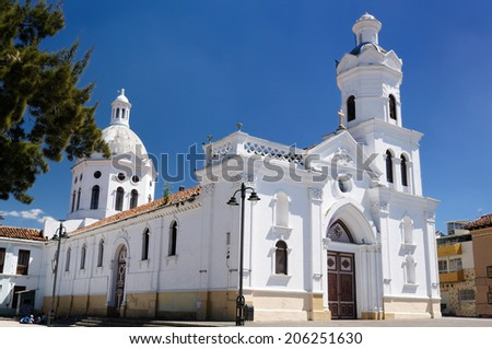 Cuenca  is a beautifllly colonial city, packed with historical monuments and architectural treasures. Cityscape - old town - colonial church - stock photo