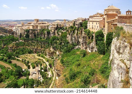 CUENCA, SPAIN - JUNE 10, 2014: Old town. The old town is an outstanding example of a medieval city, built on the steep sides of a mountain.Many casas colgadas are built right up to the cliff edge. - stock photo