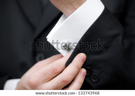 Cuff link, man is getting dressed - stock photo