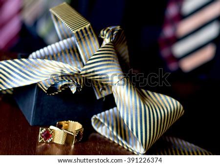 cuff links and elegant tie - stock photo