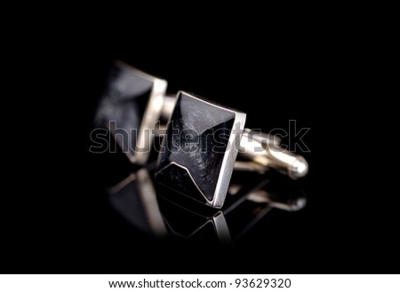 Cuff links isolated on black