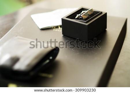 cufflinks on black box - stock photo
