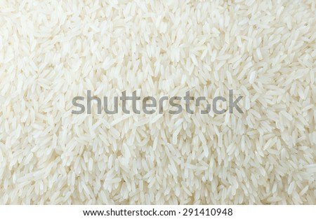 Cuisine and Food, A Background of Uncooked White Long Rice, Basmati Rice or Jasmine Rice. - stock photo