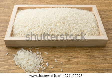 Cuisine and Food, White Long Rice, Basmati Rice or Jasmine Rice in A Wooden Tray. - stock photo