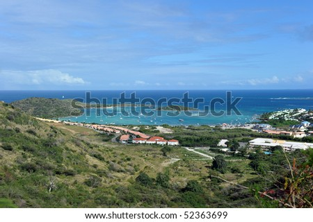 Cul de sac bay, St Martin French side, West Indies. From the beach, shuttle boats make the five-minute trip to Islet Pinel