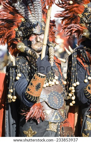 CULLAR, SPAIN - APRIL 26: Unidentified participants at Fiesta Moros and Cristianos, participate in a costume parade on the streets of Cullar, Granada April 26, 2014