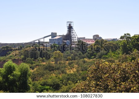 Cullinan Mine seen in the distance, famous for The Cullinan diamond the largest rough gem-quality diamond ever found, at 3106.75 carats. The mine shaft stands out distinctly. - stock photo