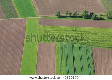 Cultivated field from above. Aerial view of meadows and cultivated fields. Birds view. Arable land. - stock photo